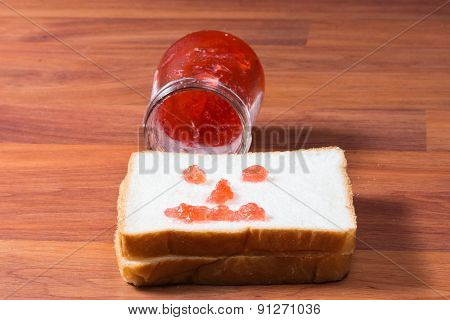 slice of bread with red jam