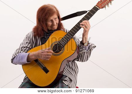 Funny Elderly Lady Playing Acoustic Guitar.