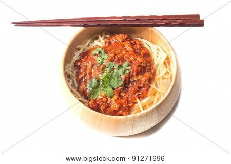 plate with spaghetti, sauce and basil