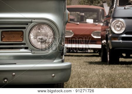 Classic cars and trucks parked in a row
