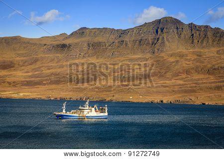 Fishing ship in Seydisfjordur fjord in Eastern Iceland