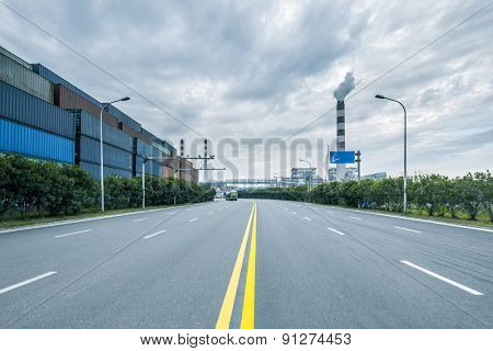 Empty road near container dock