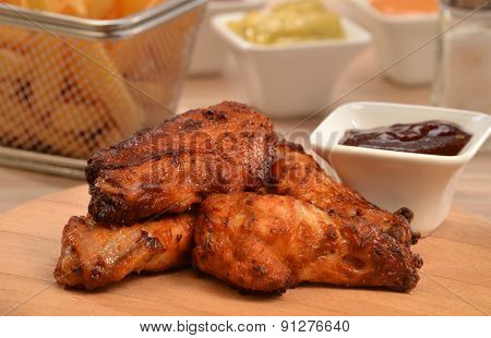 Fried chicken wings and sauce dip background.