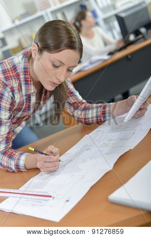 Female architect in the office