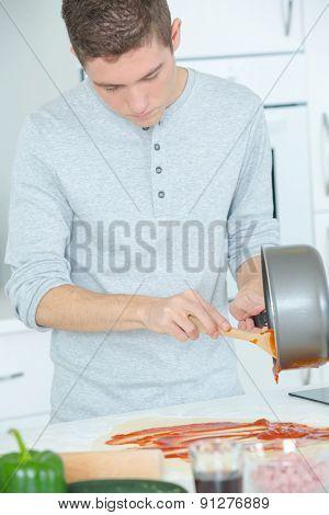 Man preparing a tomato sauce