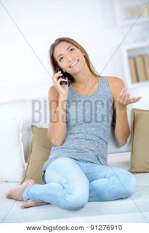 Brunette chatting on her mobile