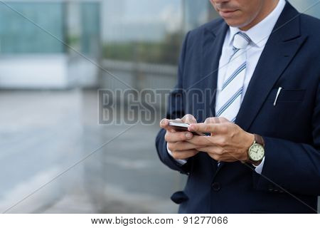 Texting businessman
