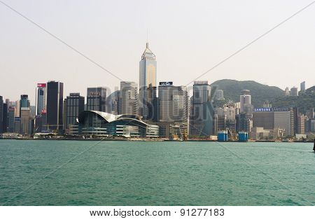 HONG KONG - APRIL 16, 2015: Victoria harbor with Hong Kong skyline in the background. Victoria Harbour is a natural landform harbour situated between Hong Kong Island and Kowloon in Hong Kong.