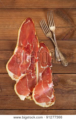 serrano ham jamon Cured Meat on wooden table