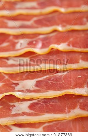 Platter of serrano ham jamon Cured Meat background texture full frame