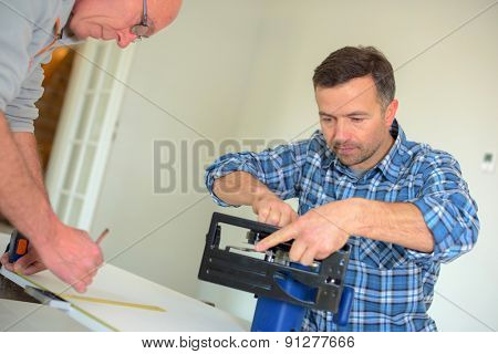 Carpenter setting up a circular saw