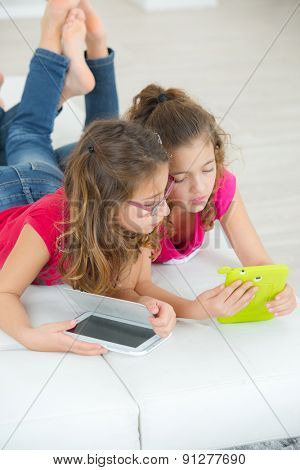 Little girls with tablet computers