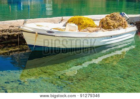 White boat with fisherman's net