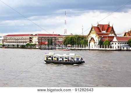 Bangkok - May 17: Wat Rakang Along Chao Phraya River With Traffice Commercial Boats In Bangkok