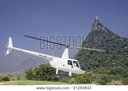 Tourist Taking A Helicopter Tour Of The Christ The Redeemer