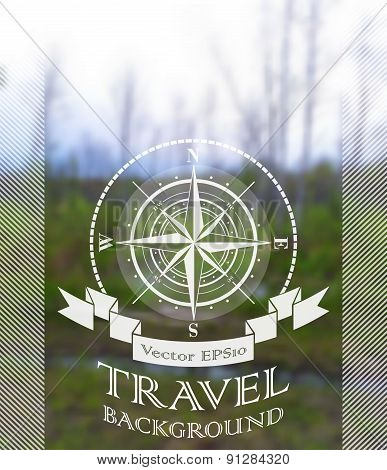 Blurred nature summer background with compass rose