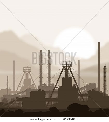 Mineral fertilizers plant over blurred mountains.