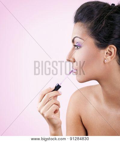 Young girl put lipstick