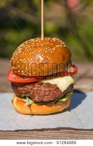 Delicious burger stacked high with a juicy beef