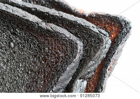 Closeup Of Three Loafs Of Burnt Bread