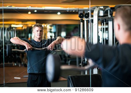 Exercising in front of mirror