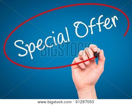 Man Hand writing Special Offer with marker on transparent wipe board.
