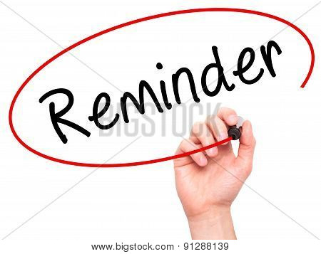 Man Hand writing Reminder with marker on transparent wipe board.