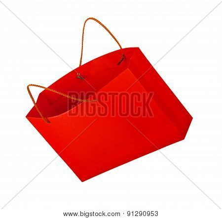 Red Shopping Bag In The Air On An Isolated White Background