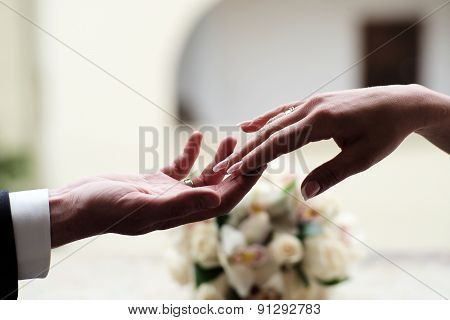 Couple At The Wedding Holding Hands