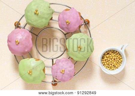 Cupcakes With Frosting On The Grid And Yellow Sugar Beads