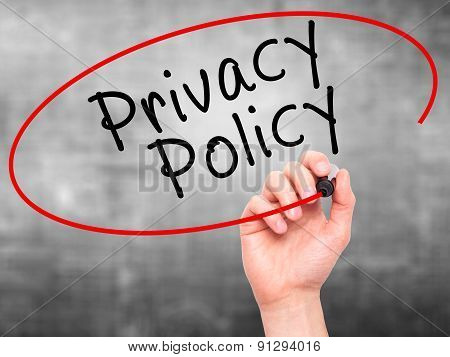 Man Hand writing Privacy Policy black marker on visual screen.