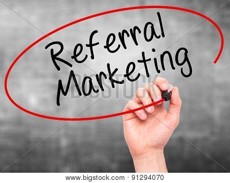 Man Hand writing Referral Marketing with marker on transparent wipe board.