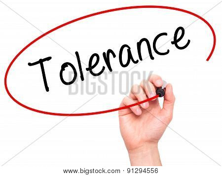 Man Hand writing Tolerance with marker on transparent wipe board.