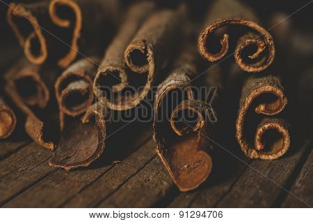 Close up of cinnamon sticks on wooden background