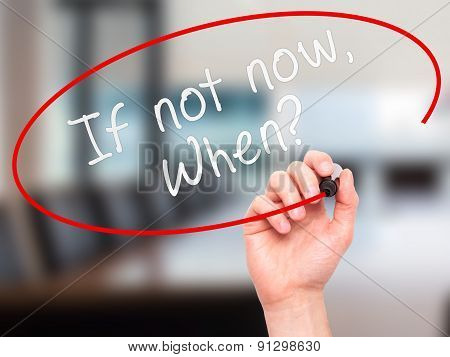 Man hand writing If Not Now When with marker on visual screen.
