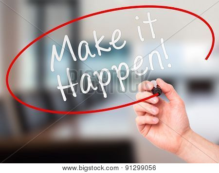Man hand writing Make it happen! on visual screen.