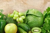 picture of assemblage  - Collection of green vegetables and fruits on wooden background - JPG