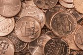 stock photo of copper  - A pile of shiny new copper pennies - JPG