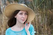 picture of windy  - Freckled girl in hat dreaming on a windy day - JPG