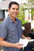 pic of mailbox  - Hispanic Man Checking Mailbox - JPG