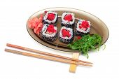 picture of chopsticks  - rolls with caviar chuka salad on a plate and chopsticks on a white background - JPG