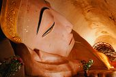 stock photo of recliner  - Close up of statue of Reclining Buddha - JPG