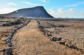 foto of dirt road  - Long Straight Dirt Desert Road disappears into the Horizon - JPG
