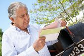 picture of mailbox  - Worried Senior Hispanic Man Checking Mailbox - JPG