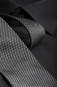 pic of black tie  - black and white tie on a black shirt - JPG