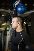 foto of kettlebell  - Kettlebell swing workout training man at gym - JPG