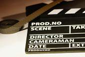 foto of mm  - Movie clapper with 16 mm film - JPG