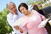 image of mailbox  - Worried Senior Hispanic Couple Checking Mailbox - JPG