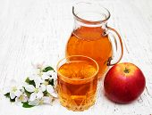 picture of pitcher  - Pitcher with apple juice with apple and blossom on a old wooden background - JPG