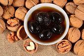 stock photo of walnut  - Top view of walnuts jam and walnuts - JPG